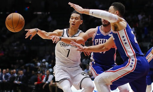 (AP Photo/Julie Jacobson, File). FILE - In this Oct. 11, 2017, file photo, Brooklyn Nets guard Jeremy Lin (7) passes the ball as Philadelphia 76ers guards Ben Simmons, right, and JJ Redick (17) defend during the third quarter of a preseason NBA basketb...