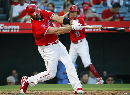 (AP Photo/Jae C. Hong). Los Angeles Angels' Albert Pujols hits a two-run home run during the first inning of the team's baseball game against the Seattle Mariners, Thursday, July 12, 2018, in Anaheim, Calif.