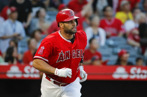 (AP Photo/Jae C. Hong). Los Angeles Angels' Albert Pujols watches his two-run home run during the first inning against the Seattle Mariner during a baseball game Thursday, July 12, 2018, in Anaheim, Calif.