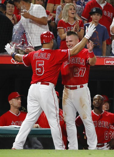 (AP Photo/Jae C. Hong). Los Angeles Angels' Albert Pujols, left, celebrates his second home run of the night with Mike Trout during the sixth inning of the team's baseball game against the Seattle Mariners, Thursday, July 12, 2018, in Anaheim, Calif.