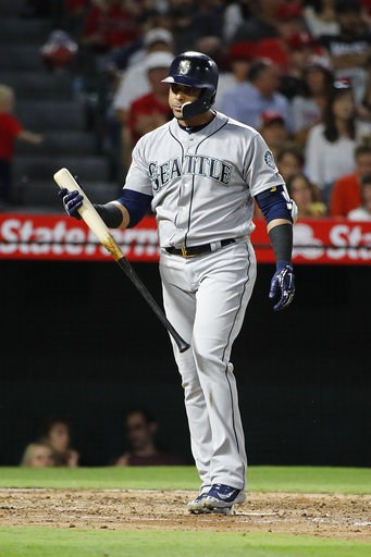 (AP Photo/Jae C. Hong). Seattle Mariners' Nelson Cruz heads back to the dugout after striking out during the fourth inning of the team's baseball game against the Los Angeles Angels, Thursday, July 12, 2018, in Anaheim, Calif.