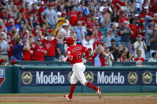 (AP Photo/Jae C. Hong). Los Angeles Angels' David Fletcher rounds the bases after hitting his first career home run during the first inning of the team's baseball game against the Seattle Mariners, Thursday, July 12, 2018, in Anaheim, Calif.