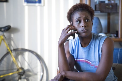 """(HBO via AP). This image released by HBO shows Issa Rae in a scene from """"Insecure."""" Rae was nominated Thursday for an Emmy for outstanding lead actress in a comedy series. The 70th Emmy Awards will be held on Monday, Sept. 17."""