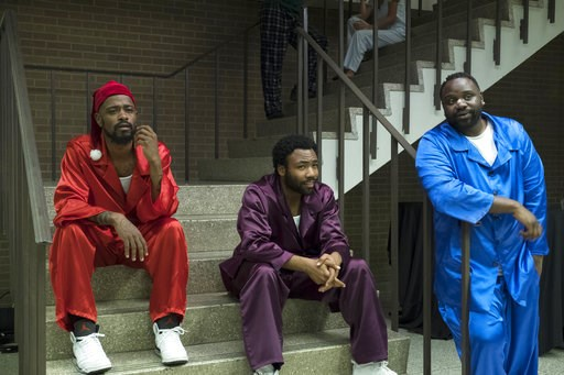 "(Guy D'Alema/FX via AP). This image released by FX shows, from left, Lakeith Stanfield, Donald Glover and Brian Tyree Henry in a scene from the comedy series ""Atlanta."" The program was nominated for an Emmy on Thursday for outstanding comedy series. Th..."