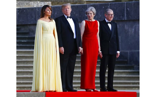 (AP Photo/Pablo Martinez Monsivais). From left, first lady Melania Trump, President Donald Trump, British Prime Minister Theresa May and her husband Philip May watch the arrival ceremony at Blenheim Palace, Oxfordshire, Thursday, July 12, 2018.