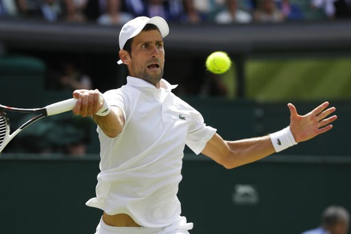 (AP Photo/Kirsty Wigglesworth). Novak Djokovic of Serbia returns the ball to Kei Nishikori of Japan during their men's quarterfinal match at the Wimbledon Tennis Championships in London, Wednesday July 11, 2018.