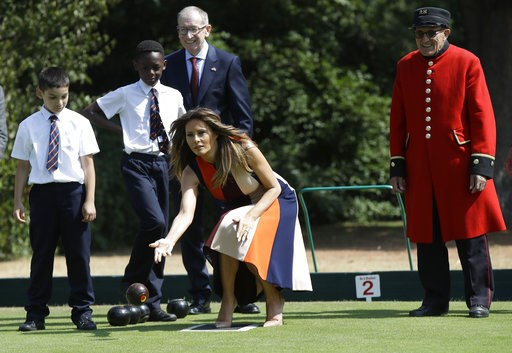 "(AP Photo/Luca Bruno, Pool). U.S. First Lady Melania Trump plays bowls she meets British military veterans known as ""Chelsea Pensioners"" at The Royal Hospital Chelsea in central London Friday, July 13, 2018. The pensioners, known for their scarlet coat..."