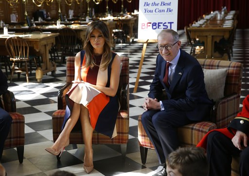 "(AP Photo/Luca Bruno, Pool). Philip May, the husband of British Prime Minister Theresa May, right, and U.S. First Lady Melania Trump take questions from school children as they meet British military veterans known as ""Chelsea Pensioners"" at The Royal H..."