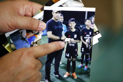 (AP Photo/Vincent Thian). Banphot Konkum, father of Duangpetch Promthep, shows a picture of his son during an interview in Mae Sai district in Chiang Rai province, northern Thailand, Friday, July 13, 2018. Banphot told The Associated Press his son, bet...