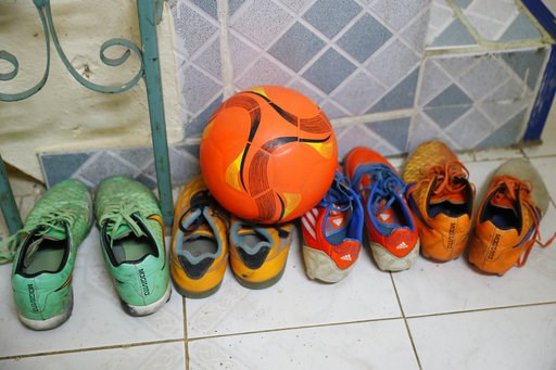 (AP Photo/Vincent Thian). A ball and soccer shoes belonging to Duangpetch Promthep, one of the rescued Thai boys, are seen in his house in Mae Sai district in Chiang Rai province, northern Thailand, Friday, July 13, 2018. The boys meant to explore the ...