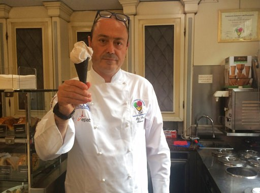(AP Photo/Daniella Matar). Owner of Gelateria Miretti, Leonardo La Porta holds an ice cream he created and named it CR7 in honour of soccer player Cristiano Ronaldo, Thursday July 12, 2018.  Ronaldo has signed to play for Juventus, prompting celebratio...