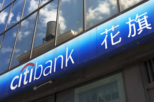 (AP Photo/Mark Lennihan, File). FILE- In this April 24, 2018, file photo, a Citibank sign is shown outside one of the bank's branch offices in New York. Citigroup reports earnings Friday, July 13, 2018.