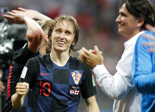 (AP Photo/Frank Augstein). Croatia's Luka Modric celebrates with head coach Zlatko Dalic after advancing to the final during the semifinal match between Croatia and England at the 2018 soccer World Cup in the Luzhniki Stadium in Moscow, Russia, Wednesd...