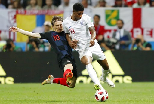 (AP Photo/Frank Augstein). Croatia's Luka Modric, left, and England's Marcus Rashford challenge for the ball during the semifinal match between Croatia and England at the 2018 soccer World Cup in the Luzhniki Stadium in Moscow, Russia, Wednesday, July ...