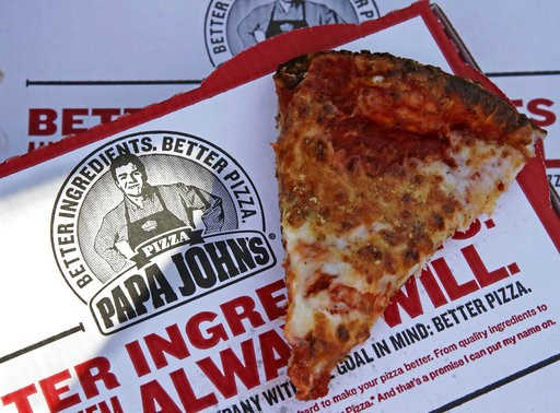 (AP Photo/Charles Krupa, File). FILE- This Dec. 21, 2017, file photo shows a slice of cheese pizza at the Papa John's pizza shop in Quincy, Mass. Papa John's plans to pull Schnatter's image from marketing materials after reports he used a racial slur. ...