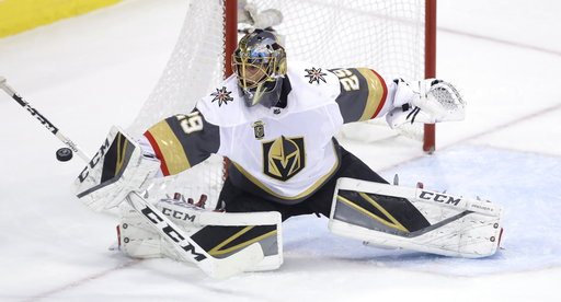 (Trevor Hagan/The Canadian Press via AP, File). FILE - In this May 20, 2018, file photo, Vegas Golden Knights goaltender Marc-Andre Fleury (29) deflects the puck wide of the net during the first period of an NHL game against the  Winnipeg Jets, during ...