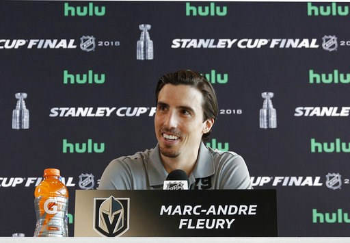 (AP Photo/John Locher, File). FILE - In this May 27, 2018, file photo, Vegas Golden Knights goaltender Marc-Andre Fleury speaks during an NHL hockey media day for the Stanley Cup, in Las Vegas. The Vegas Golden Knights have agreed to terms with three-t...
