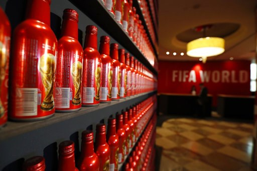 (AP Photo/Rebecca Blackwell). In this July 5, 2018 photo, Budweiser World Cup bottles line a wall in the lobby of the InterContinental Hotel, which has been taken over by Bud for the duration of the 2018 soccer World Cup, in Moscow, Russia.