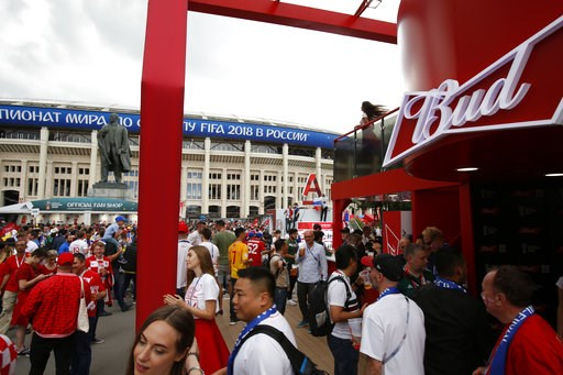 (AP Photo/Rebecca Blackwell). In this July 11, 2018 photo, people walk past a Budweiser pavilion in front of the Luzhniki Stadium as fans arrive for the semifinal match between Croatia and England, during the 2018 soccer World Cup in Moscow, Russia.