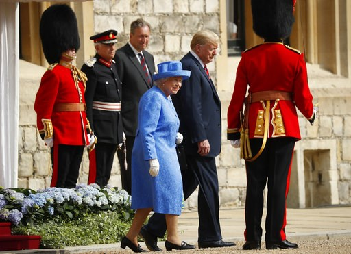 (AP Photo/Pablo Martinez Monsivais). Queen Elizabeth II and President Donald Trump walk together to inspect the Guard of Honour at Windsor Castle in Windsor, England, Friday, July 13, 2018.