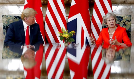 (AP Photo/Pablo Martinez Monsivais). U.S. President Donald Trump, left, with British Prime Minister Theresa May, right, during their meeting at Chequers, in Buckinghamshire, England, Friday, July 13, 2018.