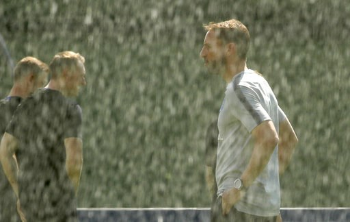 (AP Photo/Dmitri Lovetsky). England head coach Gareth Southgate attends an official training of his team at the watered pitch in Zelenogorsk near St. Petersburg, Russia, Friday, July 13, 2018, on the eve of the third place match between England and Bel...