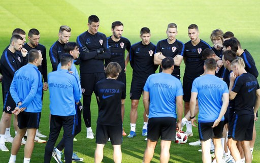 (AP Photo/Darko Bandic). Croatia players listen to their coach Zlatko Dalic during a training session of Croatian national team at the 2018 soccer World Cup in Moscow, Russia, Friday, July 13, 2018.