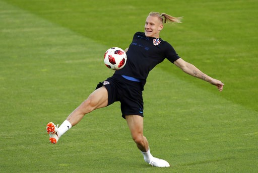 (AP Photo/Darko Bandic). Croatia's Domagoj Vida kicks the ball during a training session of Croatian national team at the 2018 soccer World Cup in Moscow, Russia, Friday, July 13, 2018.