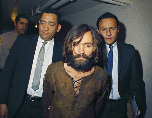 (AP Photo, File). FILE - In this 1969 file photo, Charles Manson is escorted to his arraignment on conspiracy-murder charges in connection with the Sharon Tate murder case. A Los Angeles judge has eliminated two purported sons of Charles Manson from th...