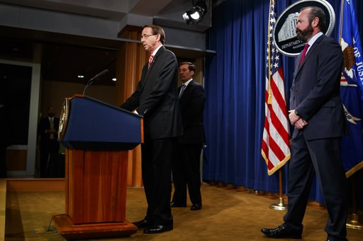 (AP Photo/Evan Vucci). Deputy Attorney General Rod Rosenstein speaks at a news conference at the Department of Justice, Friday, July 13, 2018, in Washington. From left, Assistant Attorney General John Demers, Rosenstein, and Acting Principal Associate ...