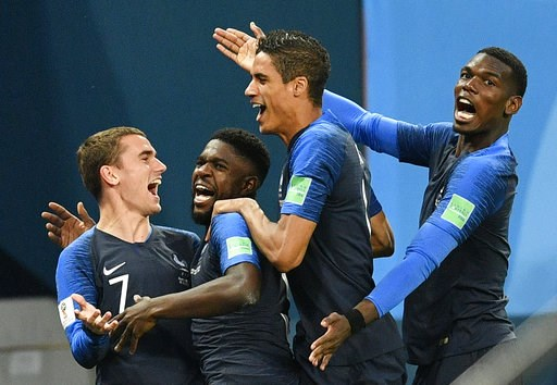 (AP Photo/Martin Meissner). France's Samuel Umtiti, second from left, is congratulated by his teammates France's Antoine Griezmann, Raphael Varane and Paul Pogba, from left, after scoring the opening goal during the semifinal match between France and B...