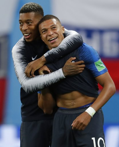 (AP Photo/Petr David Josek). France's Kylian Mbappe, right, and Presnel Kimpembe celebrate at the end of the semifinal match between France and Belgium at the 2018 soccer World Cup in the St. Petersburg Stadium, in St. Petersburg, Russia, Tuesday, July...