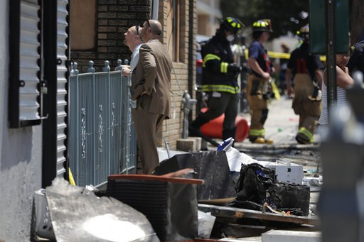 (AP Photo/Julio Cortez). Investigators stand outside of a house where two children were killed in a morning fire, Friday, July 13, 2018, in Union City, N.J.  The fire at the multifamily home started shortly before 9 a.m. Friday. It quickly consumed the...