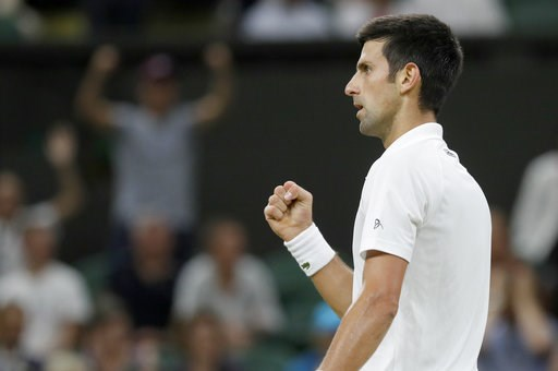 (AP Photo/Kirsty Wigglesworth). Serbia's Novak Djokovic reacts after winning a point during the men's singles semifinals match against Rafael Nadal of Spain, at the Wimbledon Tennis Championships, in London, Saturday July 14, 2018.