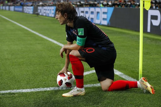 (AP Photo/Rebecca Blackwell). Croatia's Luka Modric holds the ball during the semifinal match between Croatia and England at the 2018 soccer World Cup in the Luzhniki Stadium in Moscow, Russia, Wednesday, July 11, 2018.