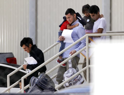 (AP Photo/Eric Gay, File). FILE - In this July 11, 2018, file photo, immigrant families leave a United States Immigration and Customs Enforcement facility after they were reunited in San Antonio. With one deadline behind, a federal judge in San Diego w...