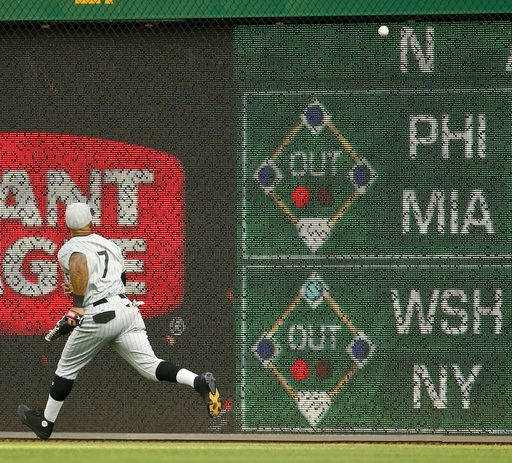 (AP Photo/Keith Srakocic). Milwaukee Brewers right fielder Eric Thames chases a fly ball by Pittsburgh Pirates' Corey Dickerson that went for a double off the wall during the first inning of a baseball game Friday, July 13, 2018, in Pittsburgh.