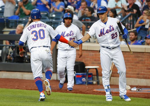 (AP Photo/Julie Jacobson). New York Mets' Michael Conforto (30) is congratulated by Matt den Dekker after scoring against the Washington Nationals during the first inning of a baseball game, Friday, July 13, 2018, in New York.