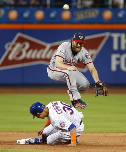 (AP Photo/Julie Jacobson). New York Mets' Michael Conforto (30) breaks up a double play as Washington Nationals second baseman Daniel Murphy makes the throw to first during the fifth inning of a baseball game, Friday, July 13, 2018, in New York. Wilmer...
