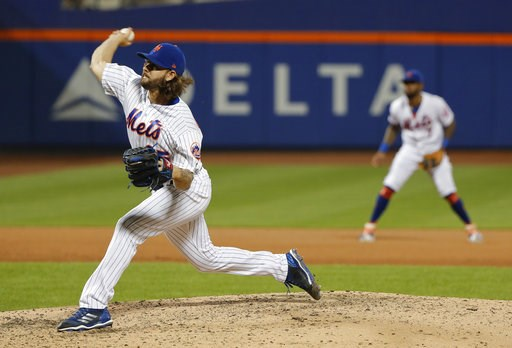 (AP Photo/Julie Jacobson). New York Mets relief pitcher Robert Gsellman, left, delivers against the Washington Nationals during the eighth inning of a baseball game, Friday, July 13, 2018, in New York.