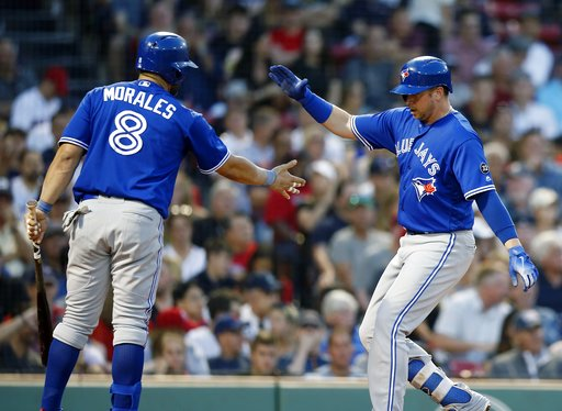 (AP Photo/Michael Dwyer). Toronto Blue Jays' Justin Smoak celebrates his solo home run with Kendrys Morales (8) during the third inning of the team's baseball game against the Boston Red Sox in Boston, Friday, July 13, 2018.