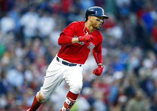 (AP Photo/Michael Dwyer). Boston Red Sox's Mookie Betts runs on his triple during the second inning of a baseball game against the Toronto Blue Jays in Boston, Friday, July 13, 2018.