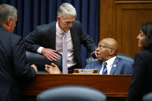 (AP Photo/Evan Vucci). Chairman of the Oversight and Government Reform Committee Rep. Trey Gowdy, R-S.C., left, speaks with the ranking member of the committee Rep. Elijah Cummings, D-Md., during a hearing with FBI Deputy Assistant Director Peter Strzo...
