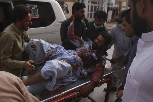 (AP Photo/Arshad Butt). People rush an injured person to a hospital in Quetta, Pakistan, Friday, July 13, 2018. Underscoring the security threat, two bombs exploded Friday killing many people in the latest election related violence to hit Pakistan. The...