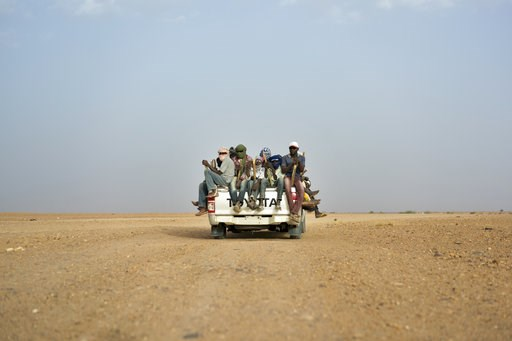 (AP Photo/Jerome Delay, File). FILE - In this Monday, June 4, 2018 file photo, Nigeriens and third-country migrants head towards Libya from Agadez, Niger. Algeria's deadly expulsions of migrants into the Sahara Desert have nearly ground to a halt after...