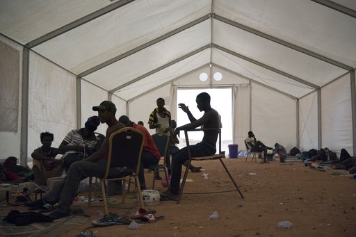 (AP Photo/Jerome Delay, File). FILE - In this Tuesday, June 5, 2018 file photo, Sierra Leone migrants who were expelled from Algeria wait for repatriation in an International Organization for Migration center in Agadez, Niger. Algeria's deadly expulsio...