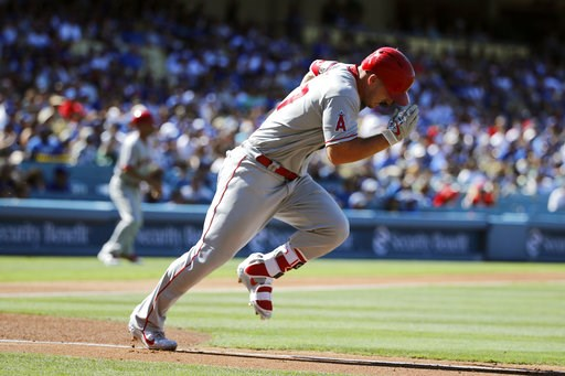 (AP Photo/Jae C. Hong). Los Angeles Angels' Mike Trout runs to first base after hitting a single during the first inning of the team's baseball game against the Los Angeles Dodgers, Saturday, July 14, 2018, in Los Angeles.