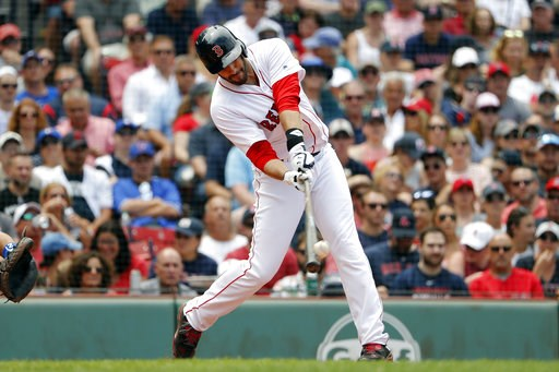 (AP Photo/Winslow Townson). Boston Red Sox's J.D. Martinez connects on a solo home run against the Toronto Blue Jays during the fourth inning of a baseball game Saturday, July 14, 2018, in Boston.