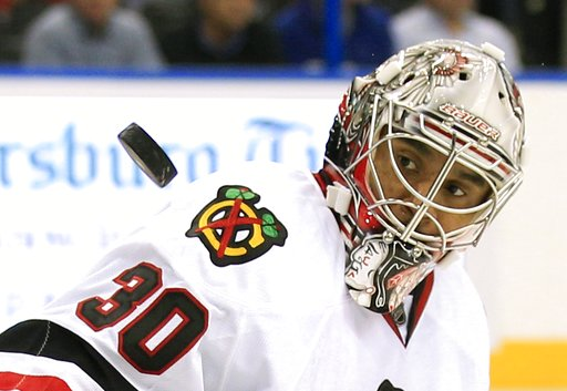 (AP Photo/Chris O'Meara, file). FILE - In this Nov. 4, 2011 file photo Chicago Blackhawks goalie Ray Emery keeps his eyes on a shot by the Tampa Bay Lightning during the second period of an NHL hockey game in Tampa, Fla. Emery has drowned in his hometo...