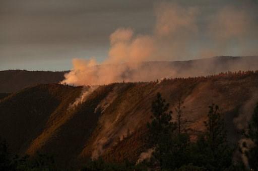 (AP Photo/Noah Berger). The Ferguson Fire burns along a ridgeline in unincorporated Mariposa County, Calif, on Monday, July 16, 2018.